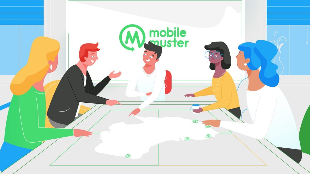 A group of people sitting around a table with a MobileMuster logo in the background.